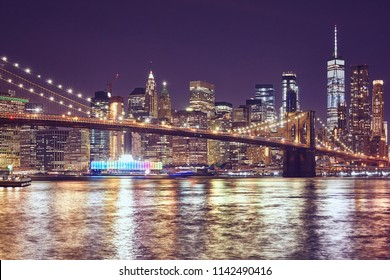 Brooklyn Bridge and Manhattan at night, color toned picture, New York City, USA.