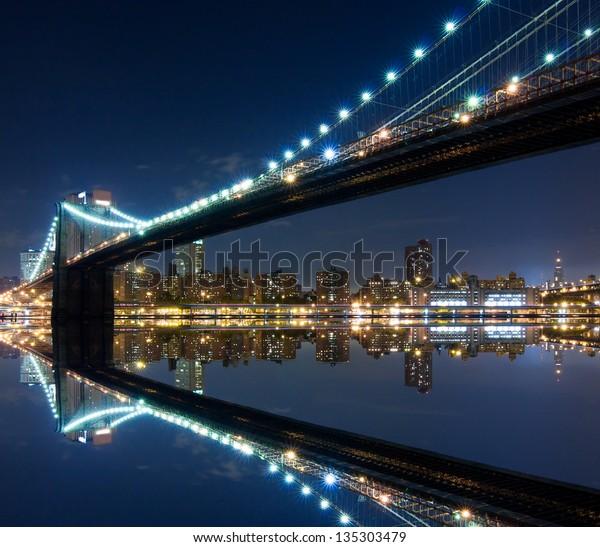 Brooklyn Bridge and Manhattan with reflections. Night scene