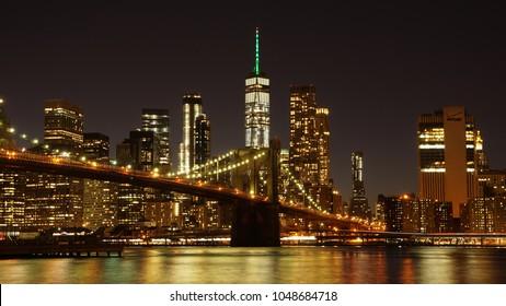 Brooklyn Bridge with Manhattan Skyline in the background in New York City.