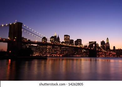 Brooklyn Bridge and Manhattan skyline at dusk - New York City, USA