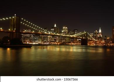 Brooklyn Bridge and Manhattan skyline at night - New York City, USA