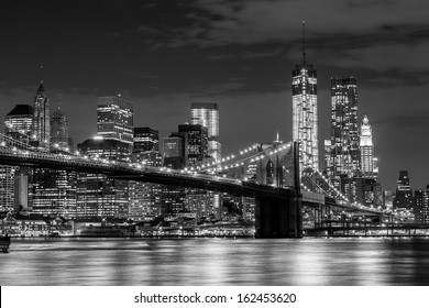 Brooklyn Bridge and Manhattan skyline at night in black and white