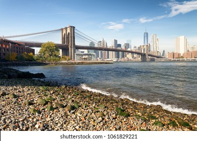 Brooklyn Bridge and Manhattan skyline as seen from Brooklyn Bridge Park, New York City - NY - USA.