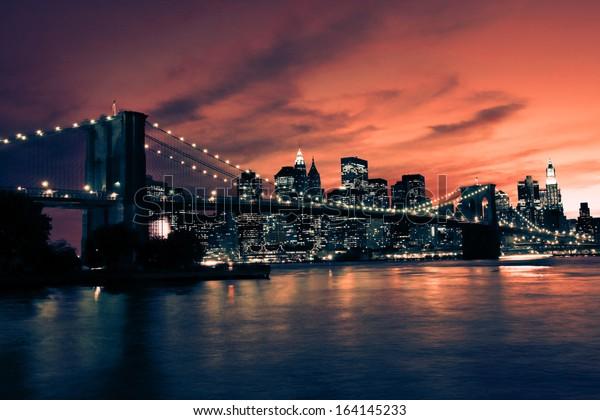 Brooklyn Bridge and Manhattan at sunset, New York, orange tone