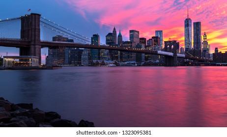 Brooklyn bridge and New York City Manhattan panorama at sunset