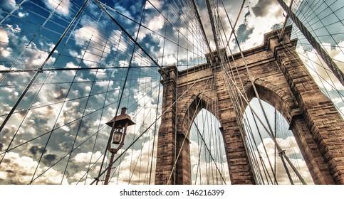 Brooklyn Bridge, New York City. Upward view with beautiful sky colors.
