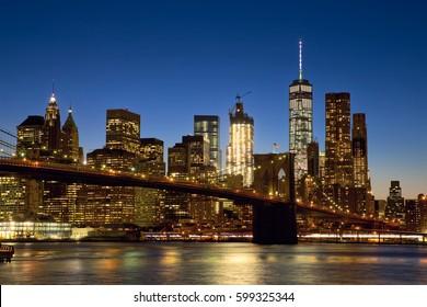 Brooklyn Bridge and New York City Manhattan skyline at dusk