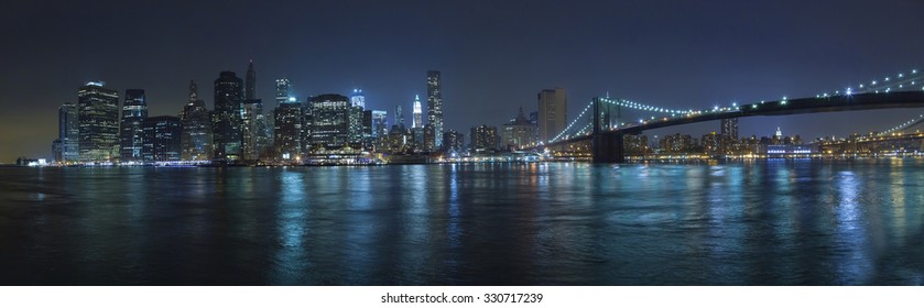 Brooklyn Bridge in New York with Manhattan in t?he night