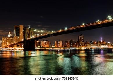 Brooklyn bridge of New York in the night. City Concept.