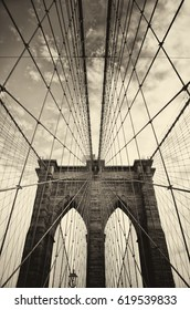 Brooklyn bridge in New York is one of the oldest bridges of either type in the United States. Completed in 1883.  Picture in sepia