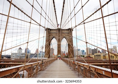Brooklyn Bridge, New York, USA. Beautiful view of Manhattan, downtown, financial district,  NYC. Manhattan midtown view panorama in financial district. Business background.
