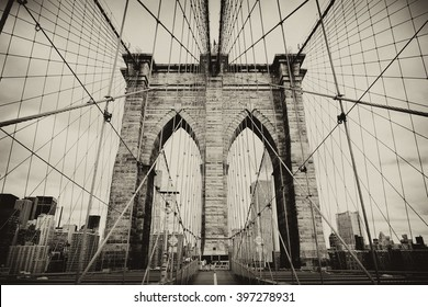 Brooklyn Bridge, New York, USA. Beautiful view of Manhattan, downtown, NYC. Midtown panorama in financial district. Business and travel background. Vintage, retro postcard with sepia filter.