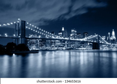 Brooklyn Bridge at night in blue cold tint
