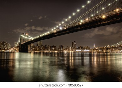 Brooklyn Bridge at night in HDR.