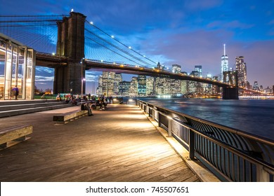 Brooklyn bridge at night with Manhattan in the background , New York