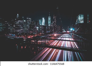 Brooklyn Bridge at night with view of New York City.