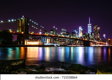 Brooklyn Bridge at Night with Water Reflection, New York City Skyline