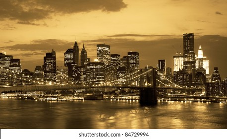 Brooklyn bridge and NYC skyline at sunset in sepia tone