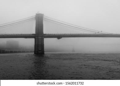 The Brooklyn Bridge on a foggy day in New York