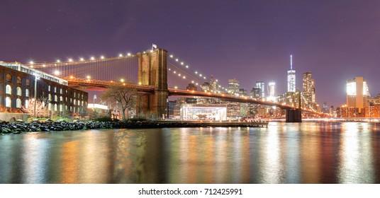 Brooklyn Bridge over East River at night in New York City Manhattan