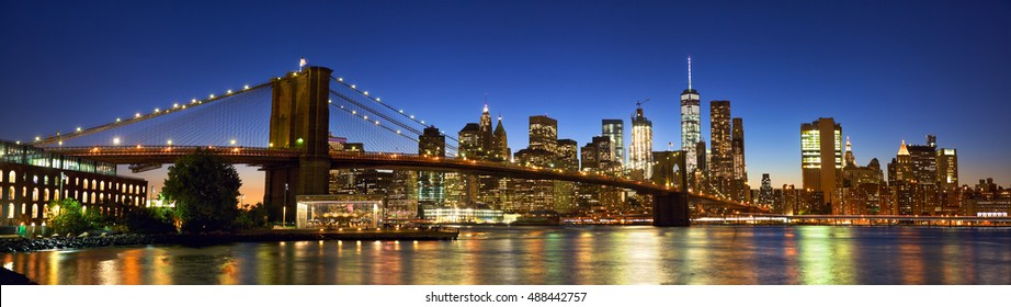 Brooklyn Bridge panorama with Manhattan skyline at dusk, New York