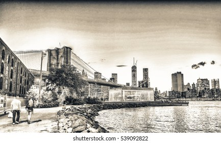 Brooklyn Bridge Park promenade at sunset, New York City.