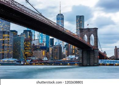 Brooklyn Bridge at sunset view. New York City, USA. Brooklyn Bridge is linking Lower Manhattan to Brooklyn.