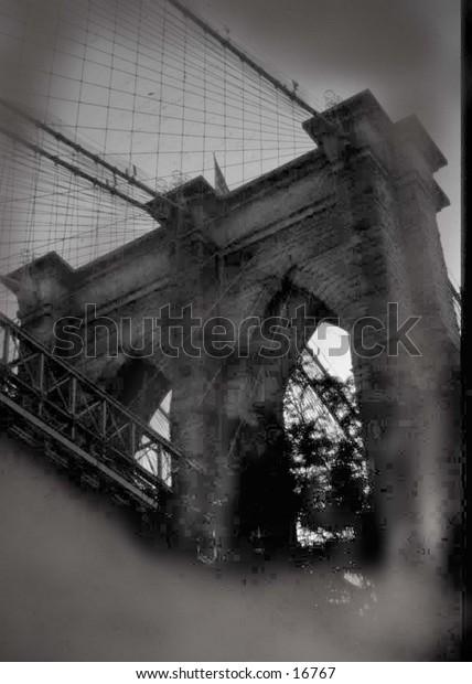 brooklyn bridge taken under bridge in black and white
