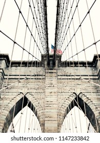 Brooklyn Bridge and the US flag, New York.
