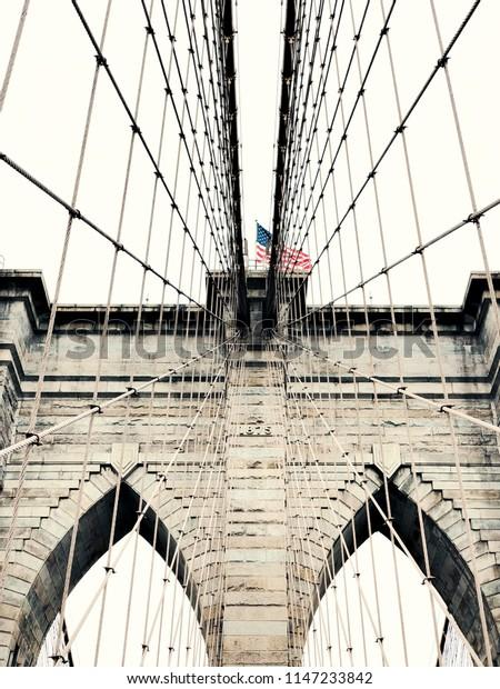 Brooklyn Bridge and the US flag, New York.