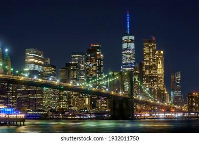 Brooklyn bridge view to Manhattan,  night light, New York, United States. 03.07.2021