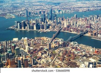 Brooklyn and Manhattan bridges from the airplane window.