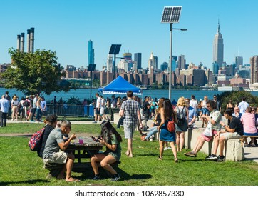 Brooklyn,, New York - 23rd September, 2017: People enjoying the outdoor food market at Smorgasburg in Williamsburg, New York. The market takes place on Saturdays in East river park