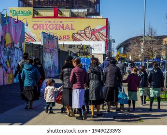 BROOKLYN, NEW YORK - APRIL 1, 2021: Jewish orthodox family enjoy outdoors during Passover at Coney Island in Brooklyn, New York