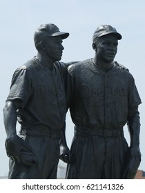 BROOKLYN, NEW YORK - APRIL 13, 2017: Jackie Robinson and Pee Wee Reese Statue in front of MCU ballpark in Brooklyn