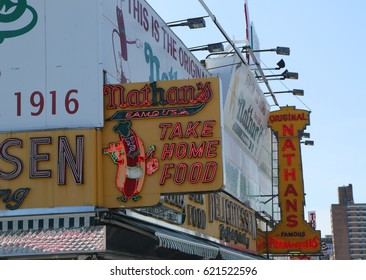 BROOKLYN, NEW YORK - APRIL 13, 2017 : The Nathan's original restaurant sign at Coney Island, New York. The original Nathan's still exists on the same site that it did in 1916.