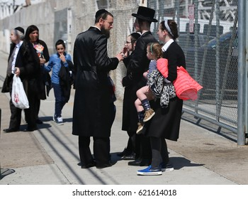 BROOKLYN, NEW YORK, APRIL 13, 2017: Jewish family enjoy outdoors during Passover at Coney Island in Brooklyn, New York.