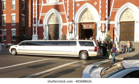 Brooklyn, New York - April 18 2008: Stretch white limo waiting for newly-weeds before Saint Anthony Church at Greenpoint
