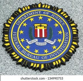 BROOKLYN, NEW YORK - APRIL 9 : FBI emblem on fallen officers memorial on April 9, 2013 in Brooklyn, NY. 71 officers were killed on September 11, 2001