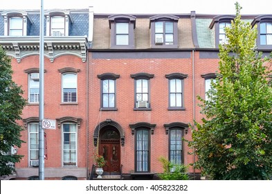 Brooklyn, New York - August 16 2014: Front of residential brick house at Kent Street in Greenpoint.