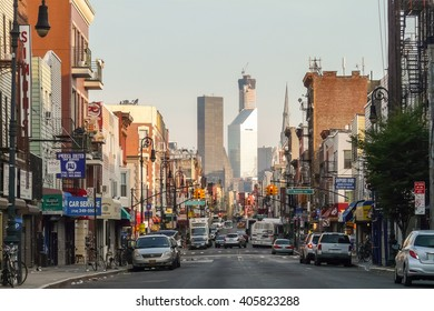 Brooklyn, New York - August 16 2014: Greenpoint's Manhattan Ave with Manhattan skyscrapers.