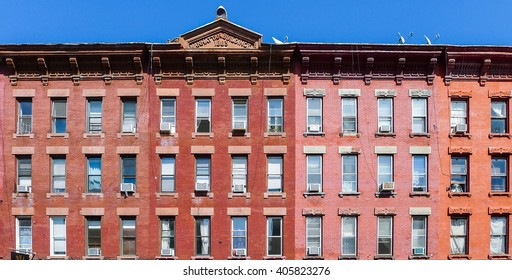 Brooklyn, New York - August 29 2014: Front of residential brick house at Manhattan Ave in Greenpoint.
