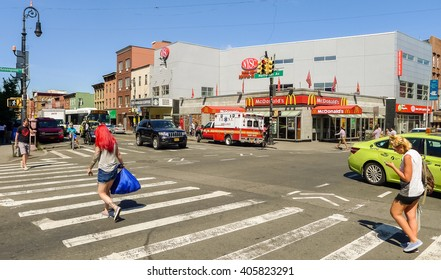 Brooklyn, New York - August 29 2014: Pedestrians walking on the crossing at center of Greenpoint.