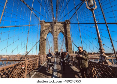 Brooklyn, New York City - April 17, 2016 : Full of tourist walking on Brooklyn Bridge in a beautiful day, New York