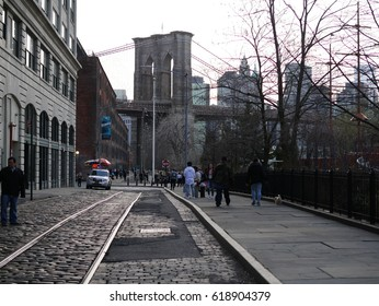 Brooklyn New York City - April 9 2017. Brooklyn Bridge at DUMBO with abandoned train track in foreground