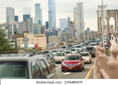 Brooklyn, New York City, USA - September 13, 2018: A view of rush hour traffic crossing the Brooklyn Bridge from Manhattan with a view of the skyline.