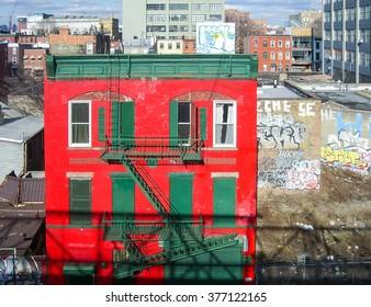 Brooklyn, New York - February 10 2007: Colorful houses near Williamsburg Bridge, some walls covered with graffiti.
