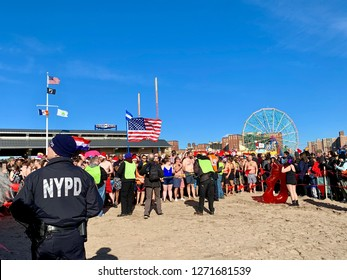 BROOKLYN, NEW YORK - January 1, 2019: NYPD officer is ensuring security during the annual New Year's Polar Bear Plunge event in Coney Island, Brooklyn, New York.