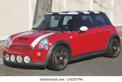 BROOKLYN, NEW YORK - JANUARY 9: Mini Cooper Hardtop car in Brooklyn on January 9, 2014. In 1999 the Mini was voted the second most influential car of the 20th century, behind the Ford Model T