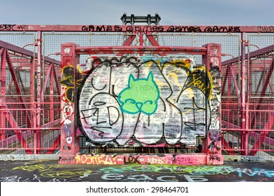 Brooklyn, New York - July 15, 2015: The Williamsburg Bridge Plaque in Brooklyn, New York. It is covered in graffiti and vandalized.